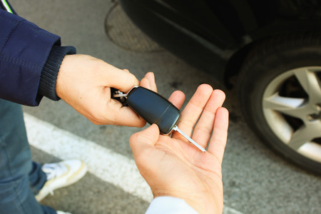 sharing: Buyer taking car key Stock Photo
