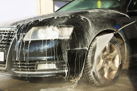 shinning light: washing the car with flowing water and foam.