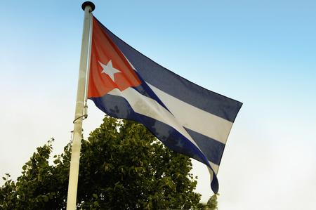 crumbling: Cuban national flag nad blue sky