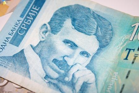 dinar: Nikola Tesla 100 dinar bill in the pile of Serbian dinars bills Stock Photo