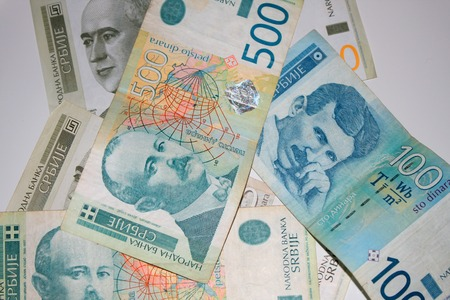 dinar: Different Serbian dinar bills scattered on white background. Stock Photo