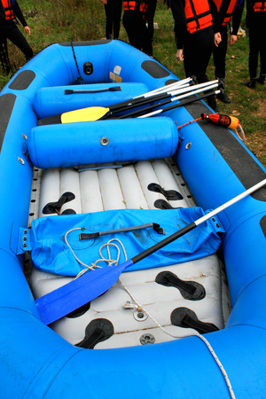 rafters: rafting inflatable blue boat wit rafters on side