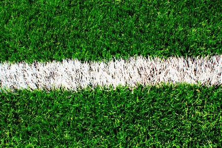 soccer field: White stripe on the green soccer field. Stock Photo