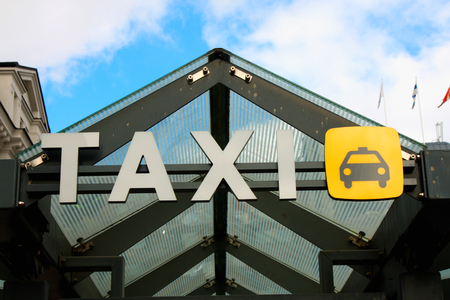 a large taxi sign in the city