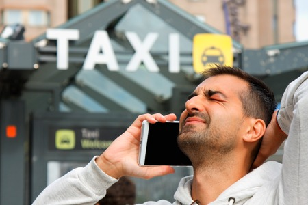 he: man feeling bad becouse he having a problem to order taxi from his cell phone