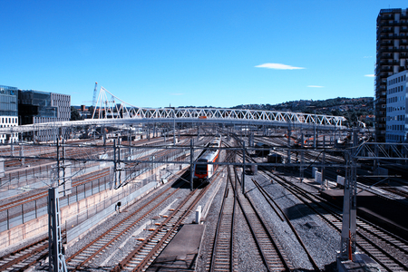 oslo: Passenger train in Norway and modern city area.