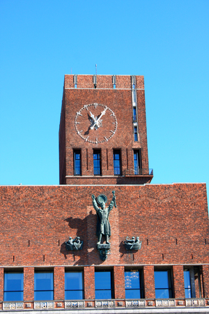 gildhall: City Hall with clock and Monuments, Oslo, Norway Editorial