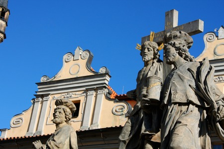 Religion statues on the Charles bridge is located in Prague, Czech Republic.