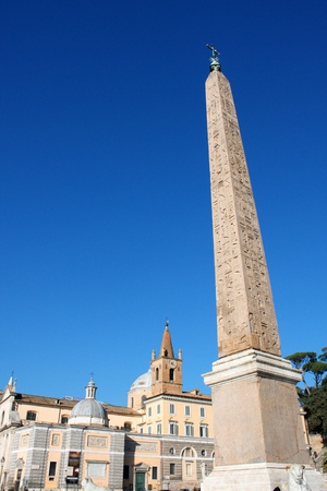 obelisk stone: Egyptian Obelisk with star and cross in Piazza del Popolo in Rome Italy