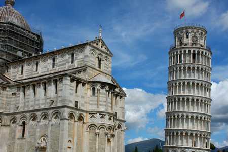 Leaning tower and Pisa cathedral on a bright sunny day in Pisa, Italy