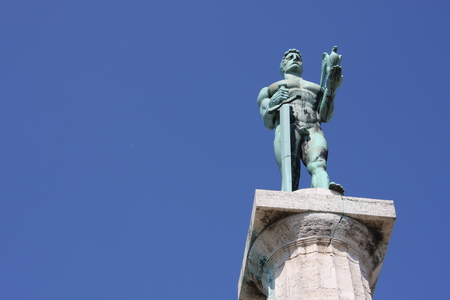 Monument sculpture of the Belgrade Victor made of bronze, located in Kalemegdan park facing the Sava River and Zemun district, Belgrade, Serbia.
