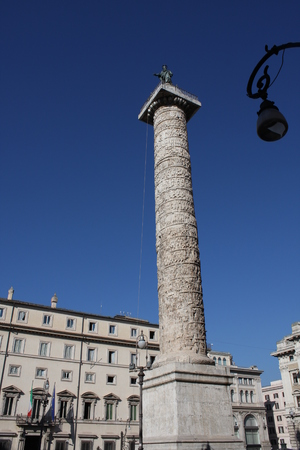 The marble Column of Marcus Aurelius in Piazza Colonna square in Rome, Italy. It is a Doric column about 100 feet high built in 2nd century AD and featuring a spiral relief. Editorial