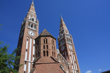 The Votive Church and Cathedral of Our Lady of Hungary is a twin-spired roman catholic cathedral in Szeged, Hungary. It lies on Dom Ter square beside the Domotor tower.