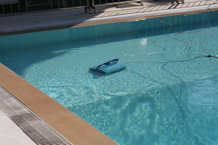 Robot working and cleaning inside swimming pool