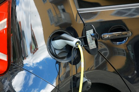 Plug in for Vehicle with an electric motor. Eco car. Reklamní fotografie