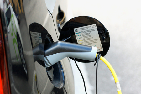 Plug in for Vehicle with an electric motor. Eco car. Stockfoto