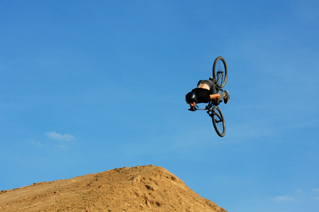 A person on trial bicycle flying over the camera