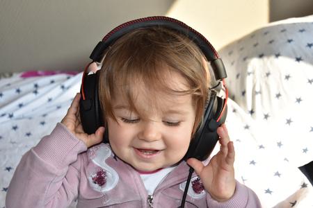 baby with headphone. young DJ Reklamní fotografie