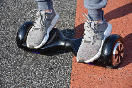 young man riding on the Hoverboard in the park Reklamní fotografie