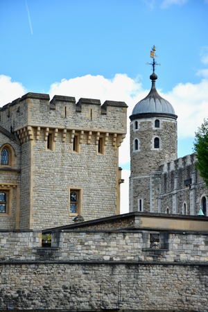 The famous White Tower and the Tower of London from South Bank across the River Thames. Popular historical tourist attraction on a summer day.  Redakční