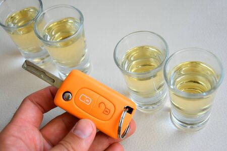 Drink and drive and alcoholism concept. Safe and responsible driving concept. Stock Photo