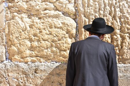 Jews in praying at the Wailing Wall in Jerusalem, Israel.