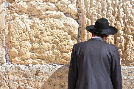 Jews in praying at the Wailing Wall in Jerusalem, Israel.