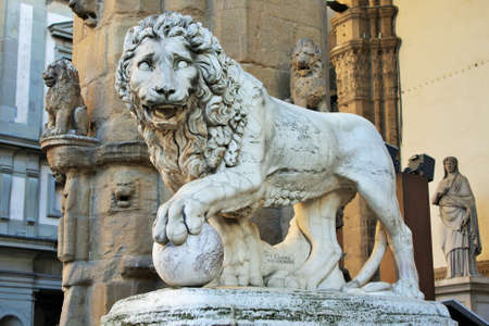 Florence, Tuscany, Italy: ancient statue of a lion in Piazza della Signoria, sculpture that depicts a lion with a sphere under one paw