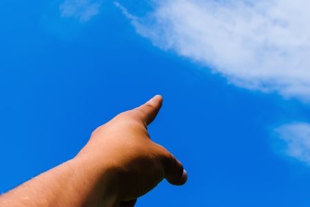 stretched out: mans hand stretched out against the blue sky