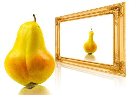 pear looks at her reflection in the mirror photo