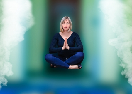 Woman flies off the ground in the lotus position Stock Photo - 24774729