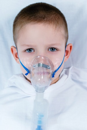 boy with a mask on the face for breathing photo