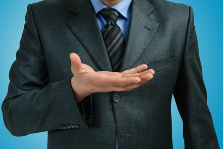 bridging the gap: man in a suit with an outstretched hand Stock Photo