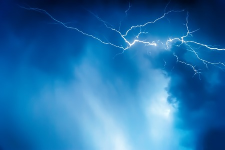 lightning strike: Lightning on the sky is covered with gray clouds in rainy season Stock Photo