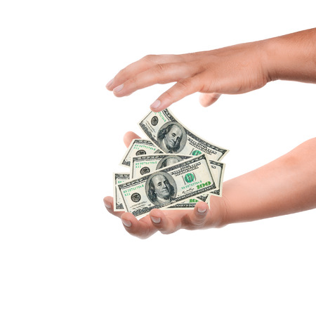 make money: male hand holding currency over white background