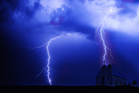 Lightning on the sky is covered with gray clouds in rainy season photo