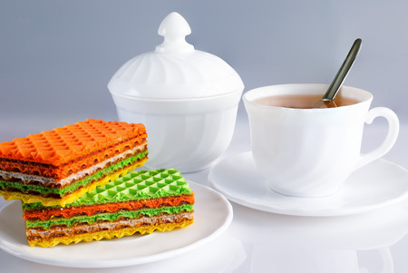white dishes with a tea drink and homemade cakes photo