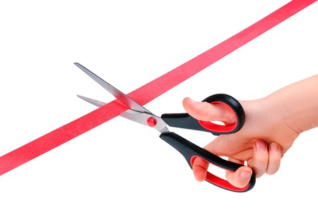 roped off: the boys hand with scissors cutting red ribbon