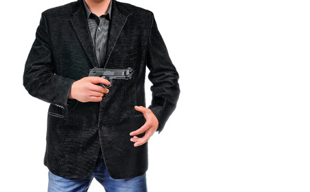 pull out: Gangster pulls out a gun businessman pull out gun from jacket concept for aggression - isolated on white background Stock Photo
