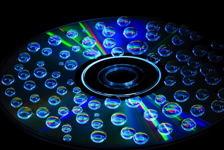 drops of water: colorful water drops on CD DVD disc Stock Photo