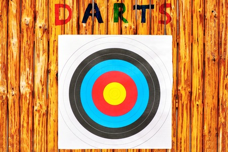 entertainment center: New colorful Darts on the background of wooden boards Stock Photo