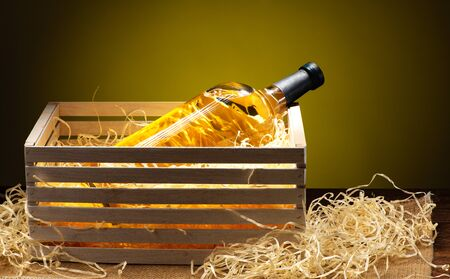 Bottle of white wine in gift wooden box