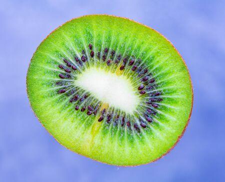 Kiwi fruit. Slice of kiwi fruit on a blue background