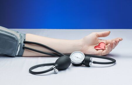 tonometer measures the pressure of woman a doctor appointment