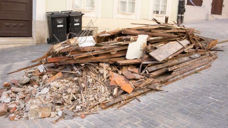Zagreb, Croatia-May 4th, 2020: Pile of debris, broken off bricks, walls and construction lying on the street in Zagreb after strong earthquake damaged older buildings