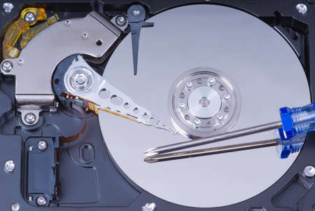 Hard drive maintenance with blue screwdriver