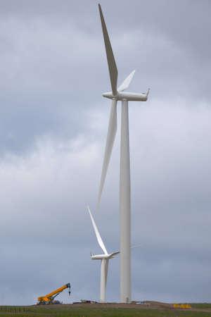 heavy machinery: Wind turbine farm construction with heavy machinery