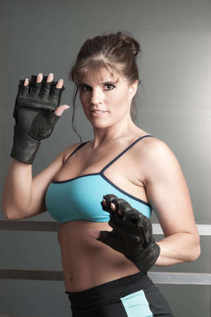 Mature female athlete at kickboxing  practice