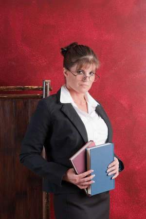 conservative: Conservative female teacher looking above the glasses Stock Photo