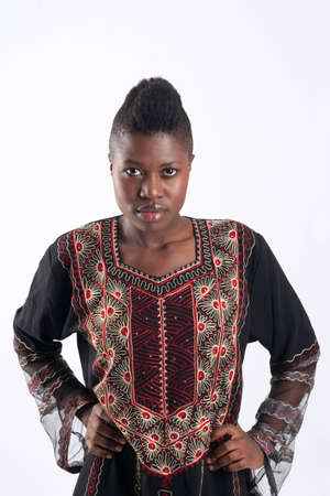 sternly: African american woman traditional dress looking sternly Stock Photo